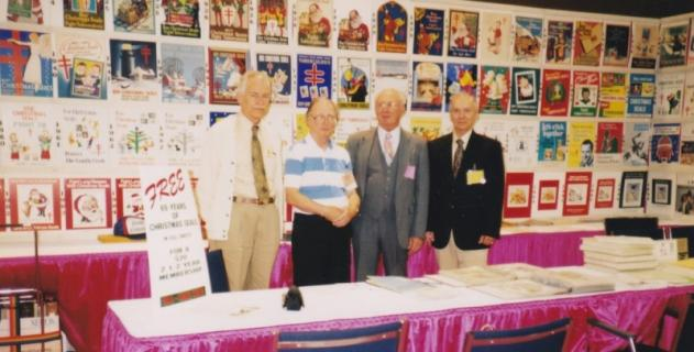 Joe Wheeler (3rd from left) with Christmas Seal poster collection on display