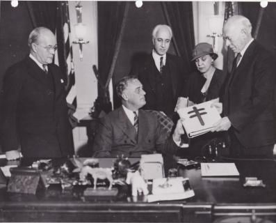 1933 publicity photo of Christmas Seal Album being presented to the President. Dr. Wm Charles White, Pres DC TB Assn, FDR, Dorsey Wheless, CS&CSS member who put the collection together, unknown woman, Dr. Kendall Emerson, Director of the NTA.