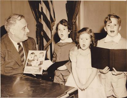 1940 publicity photo of President FDR meeting child models of the Christmas Seal